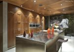 Custom Cabinetry and Stainless Steel Features in First Level Kitchen